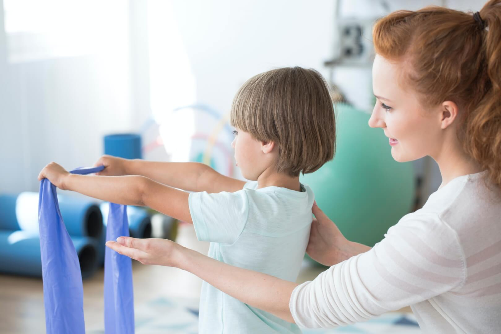 physiotherapist-supporting-kid.jpg