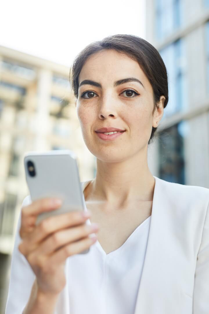 young-businesswoman-holding-smartphone.jpg