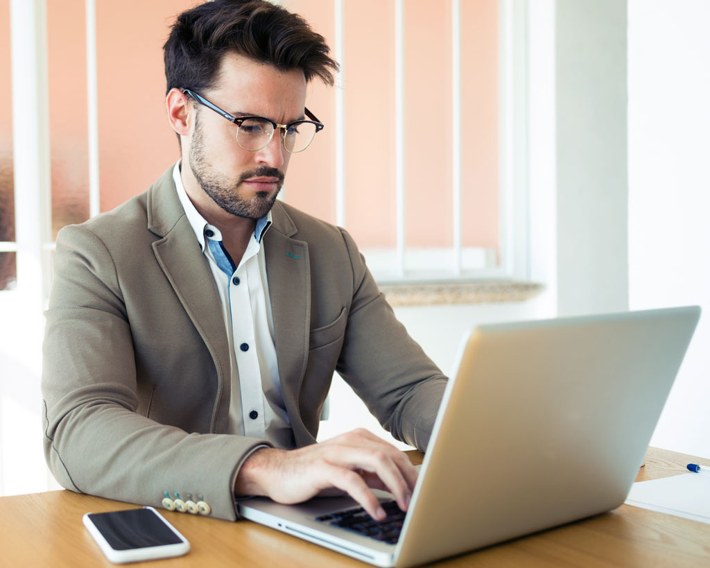 handsome young business man working with laptop in 6G9V222