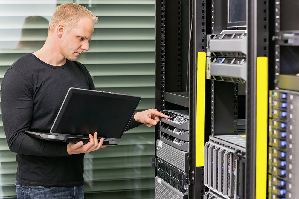 it consultant working with servers P9Z8P7X min