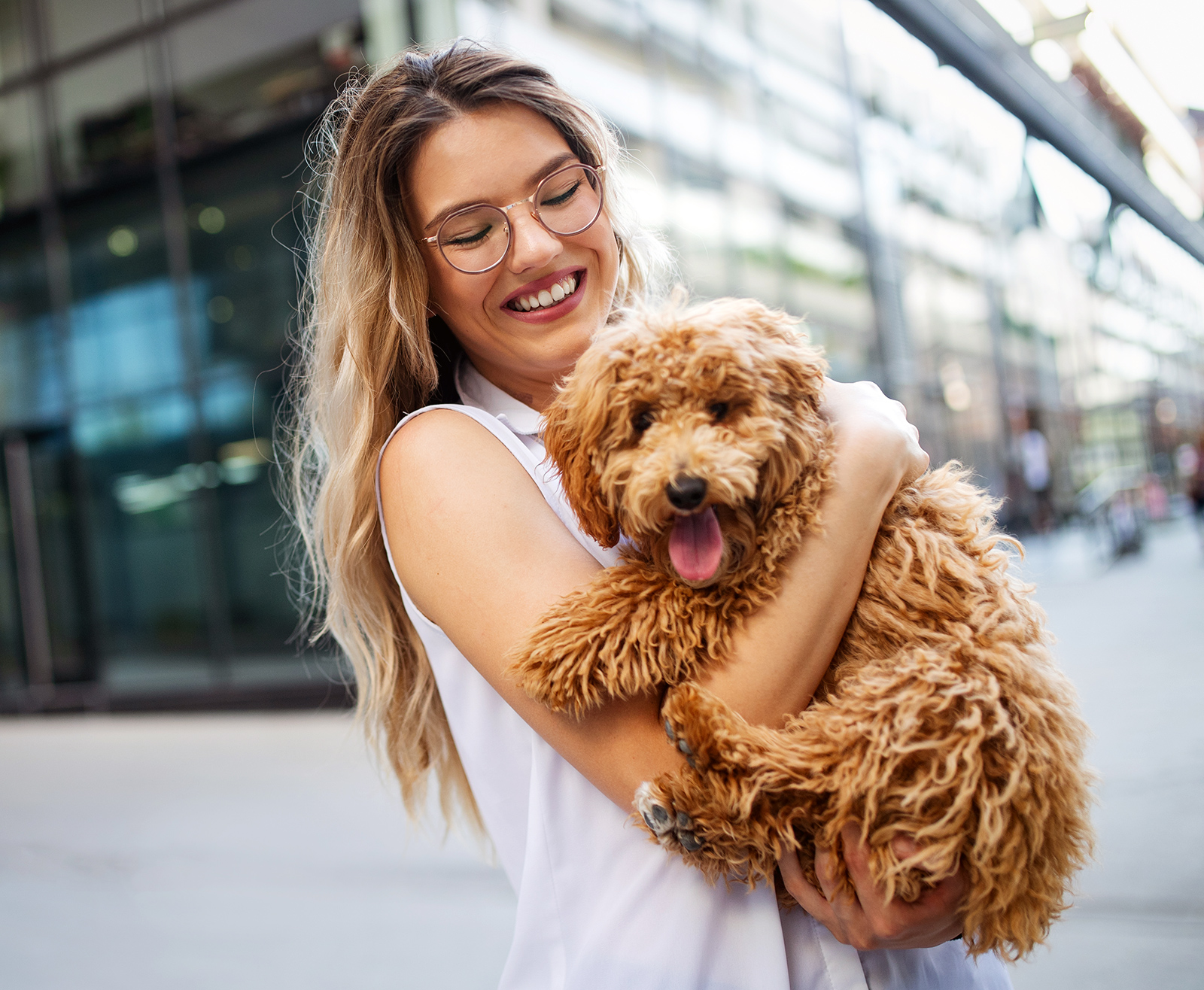 beauty-woman-with-her-dog-playing-outdoors-LN2XF4U.jpg
