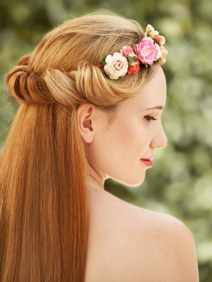 portrait of beautiful woman flowers hairstyle 7QV2E96