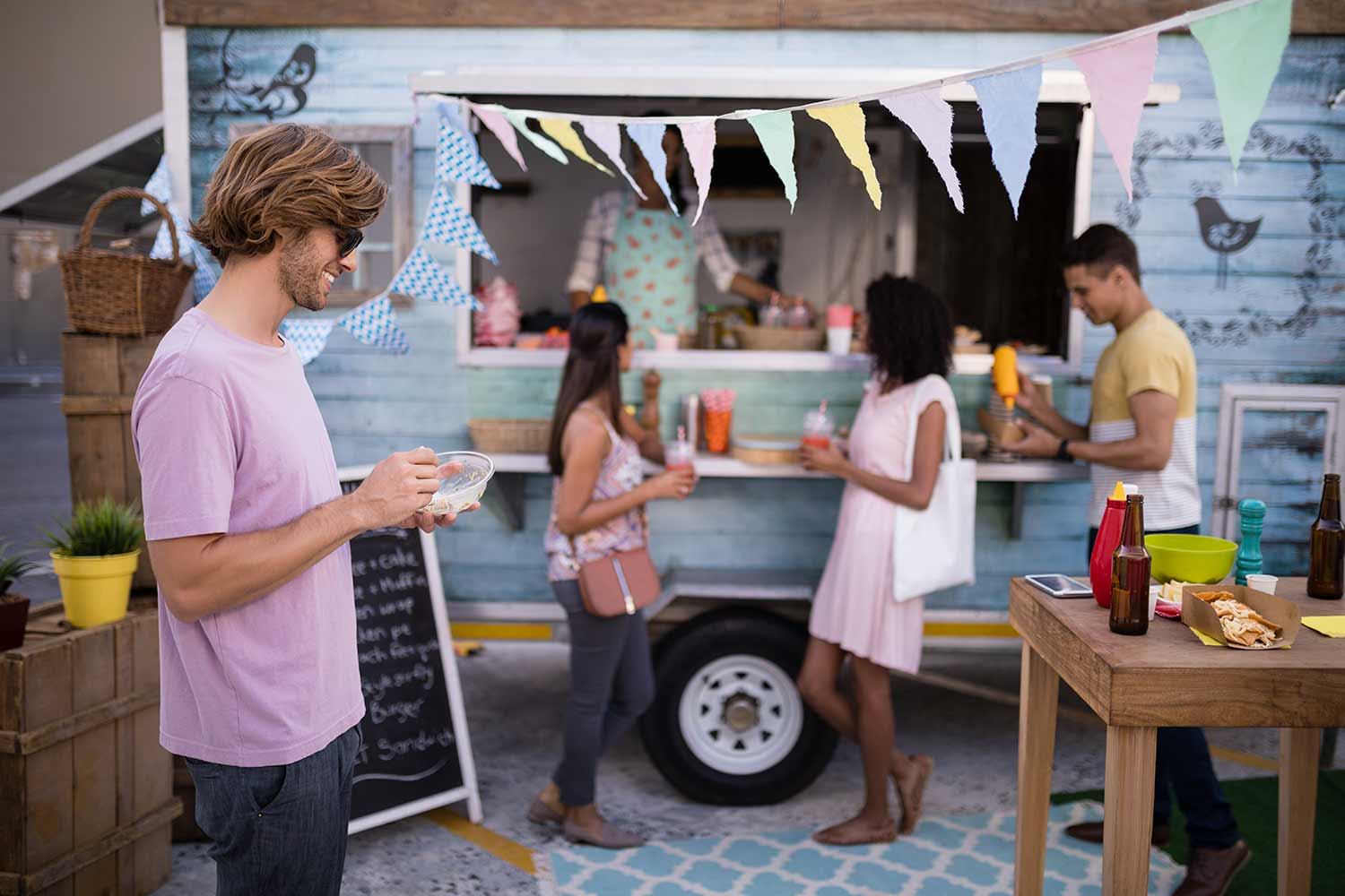 customers-having-snacks-from-food-truck-EDLBVPX.jpg