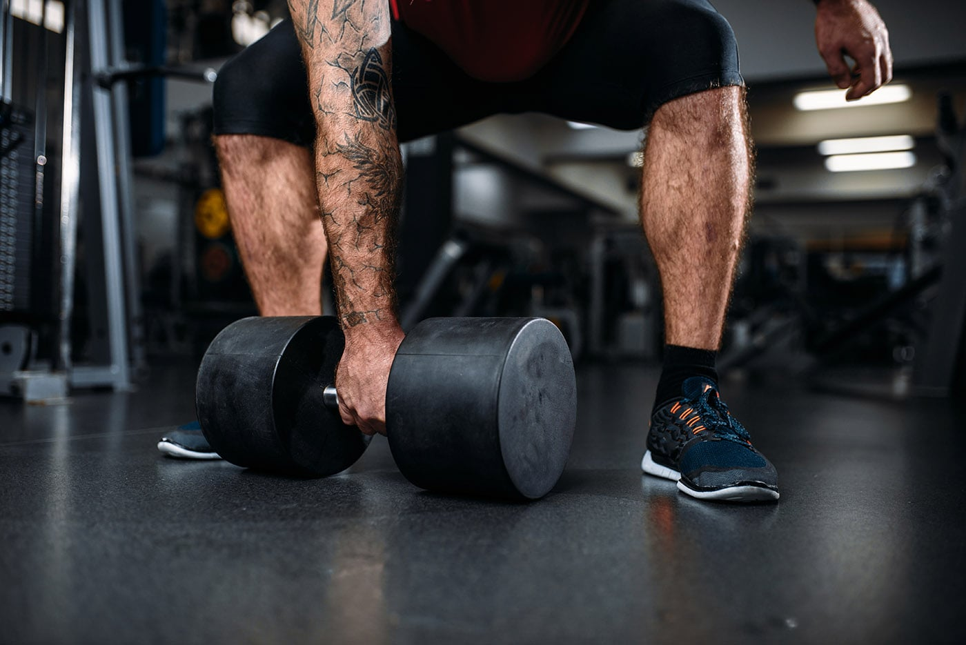 male-person-with-dumbbell-training-in-gym-37LACSK-min.jpg