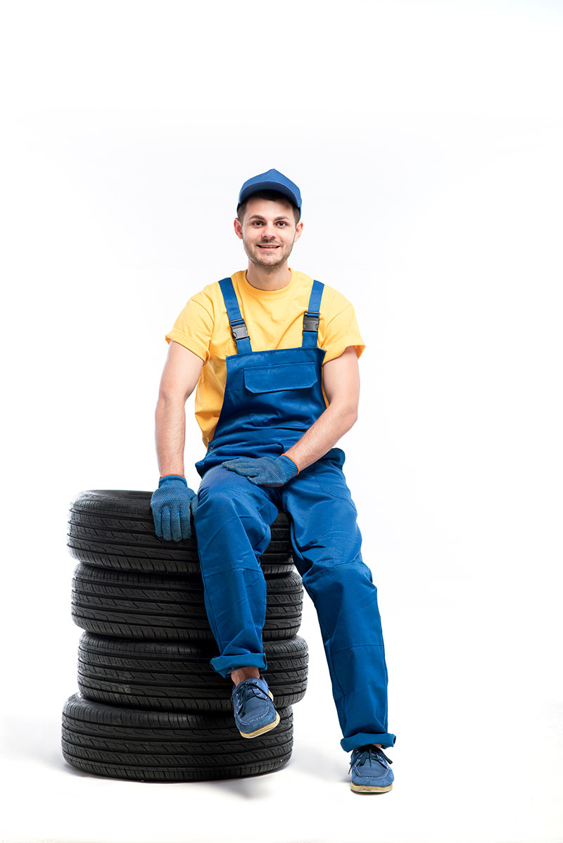 tire serviceman isolated on white background PK3Y4WV