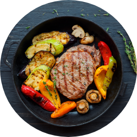 Grilled beef steak on dark wooden table background top view