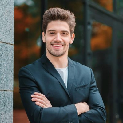 portrait-of-young-successful-confident-businessman-in-the-city-on-office-building-background-man-in_t20_AlnLA0-e1595815123529.jpg